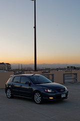 Mazdaspeed3 (BenWest2012) Tags: sunset mountains car canon evening colorado parkinggarage 28mm el tokina co dxo gt mazda frontrange manualfocus hatchback 5door mazdaspeed goldenlight primelens manuallens 20085 arapahoecounty xti mazdaspeed3 greenwoodvillage 400d canonxti greenwoodvillagecolorado tokinael28mmf28 metrogray mazdaspeed3gt pktoeos tokinael