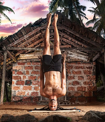 No Hands Headstand (Dreadlock Stand Pose) by Hawah near fisherman hut at sunset in India.