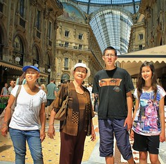 A family get together in Milan (Bn) Tags: street city blue summer sky italy sun holiday money milan hot window weather shop mall shopping walking square cuisine louis topf50 warm italia catholic cathedral roman top milano pigeons centre sightseeing restaurants sunny tourist gucci milaan ii covered shops summertime marble piazza duomo charming exquisite middle too prada ages galleria romans attractions emanuele vittorio luxurious duomodimilano louisvutton vutton 35c 1386 50faves atmospheres dommdemilan