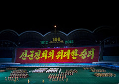 Arirang Mass Game In May Day Stadium, Pyongyang, North Korea (Eric Lafforgue) Tags: show people color colour horizontal night asian creativity outdoors photography togetherness clothing war asia nightshot outdoor stadium propaganda mosaic flag politics capital performance panoramic celebration event mass mayday multicolored awe performer stade northkorea traditionalculture skill axisofevil pyongyang dictatorship occupation dprk stalinist traditionalclothing arirang capitalcities choregraphy traveldestinations colorimage teamevent traditionalfestival northkorean highangleview traveldestination stagecostume democraticpeoplesrepublicofkorea artscultureandentertainment massgames celebrationevent peopleinarow unrecognizableperson maydaystadium dpkr performingartsevent koreanscript massgame rungrado massmouvement largegoupofpeople eti2215