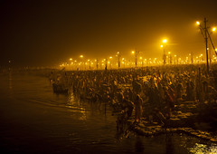 Pilgrims Bathing In Ganges, Maha Kumbh Mela, Allahabad, India (Eric Lafforgue) Tags: travel people india tourism water festival night river outdoors photography togetherness bath asia day religion bank celebration event spirituality copyspace bathing riverbank hinduism pure pilgrimage religiouscelebration pilgrim traditionalculture sangam humaninterest allahabad socialgathering haridwar purification gangesriver yamunariver uttarpradesh realpeople 1783 kumbhmela traveldestinations colorimage indianculture uttarakhand largegroupofpeople unrecognisableperson indiansubcontinent royalbath celebrationevent traditionalceremony shahisnan indianethnicity
