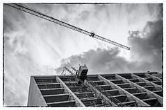 Destruction (shlomo2000) Tags: houses bw building travelling stone silver concrete deutschland 60s noir flat crane framed sightseeing kln 70s fujifilm nik blanc x100 schwarzweis nordrheinwestphalen efex