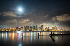 Full Moon over San Diego (Justin in SD) Tags: ocean city moon reflection water skyline night marina canon bay harbor downtown cityscape sandiego fullmoon metropolis canon5d harborisland hdr sandiegobay canon5dmarkiii 5d3 5dmark3