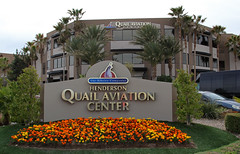 Quail Aviation Center - Henderson Executive Airport - Henderson, NV (tossmeanote) Tags: flowers orange building yellow canon palms eos airport aviation nevada center nv henderson executive ribeiro marigolds quail companies hnd 24105 2013 60d khnd tossmeanote