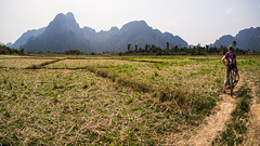 Cycling through the countryside in Vang Vieng (Miha Pavlin) Tags: trip vacation mountain bicycle person se cycling countryside asia fisheye adventure limestone southeast laos lao vangvieng carst vang vieng