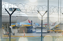 Out of bounds (pentlandpirate) Tags: fence airport cargo airlines freight razorwire manchesterairport ringway