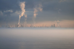 petro-dream (Mr. Greenjeans) Tags: morning mist water fog landscape louisiana foggy batonrouge mississippiriver refinery exxon oilrefinery canonef28135mmf3556isusm