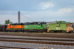 Two BNSF GP38's sit coupled to Burlington Northern's extended-vision cupola caboose No. 12500. (andrew_busse) Tags: andrew busse photography trains train railroad railway bnsf burlington northern santa fe iowa midwest rail yard caboose cupola extendedvision mississippi river summer gp38 gp382r bn green pumpkin orange bridge emd locomotive no number 2892 2286 12500
