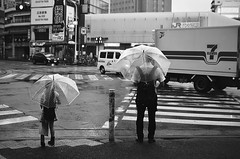 (Corblate) Tags: french girl travel tokyo japan asia rainy day black white nikon d5100 natural light passerby japanese people umbrella