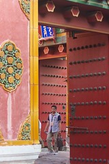 big red door (diminoc) Tags: forbiddencity door red massive knobs chinese beijing china man person through slogan architecture streetphotography