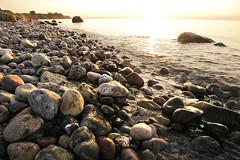 Stone Beach (parkerbernd) Tags: stone beach shiny rocky shore shoreline sunset backlight flat water baltic sea rocks explore