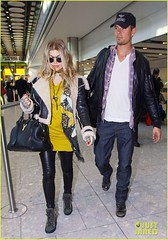 FFN_IMAGE_51017863|FFN_SET_60060489 (BlackEyedPeasPhotos) Tags: london hat sunglasses airport unitedkingdom bluejeans blondehair fergie yellowshirt whiteshirt baseballcap buttondownshirt blackleatherjacket joshduhamel blackhandbag blackleatherpants