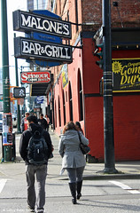 Malone's Bar & Grill (gerry.bates) Tags: signs canada architecture vancouver canon buildings design downtown britishcolumbia structures streetscene pedestrians crosswalk trafficsigns granvillestreet neonsigns cityview lampposts bargrill semourstreet