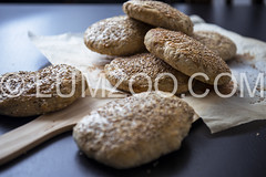 rustic homemade burger buns with sesame (LUMZOO) Tags: food bread nobody homemade griddle hamburger curve flour bluelight baked sesam healthyeating colorimage wholemealbread healthylifestyle greaseproofpaper rusticbread roundloaf burgerbunsfood