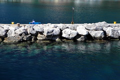 Waiting can be a pleasure (Elios.k) Tags: old blue sea summer vacation man travelling water lamp colors hat horizontal port bench outdoors person one boat rocks sitting post harbour wave tourist clear greece breaker ithaka ionian ithaki frikes