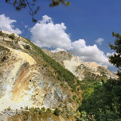 The fascinating marble mountains of Carrara (Bn) Tags: blue trees roof summer chimney italy sun house mountains alps history abandoned rock stone clouds walking landscape ancient topf50 italia quiet hiking path trails tunnel trail tuscany mines di fields chestnut cave marble monte michelangelo viewpoint surrounding scenics carrara panaroma settlement apuane rifugio quarrymen no38 apuan quarries ligurian colonnata 50faves inhabit quarrying fantiscritti sagro 40bc montecarrara