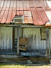 Old Board and Batten Cabin:  Near Ashland, Bertie County, North Carolina (EdgecombePlanter) Tags: abandoned chair rust decay rusty rusted porch dilapidated