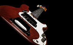 Precision (Danny Shrode) Tags: fender bass precision guitar red blackbackground music stringedinstrument guitarlove depthoffield dof