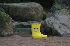 Spongebeach (frisiabonn) Tags: beach sand breakwaters water welly yellow spongebob bob square pants sponge funny wtf boot clothing clothes shore new brighton england uk
