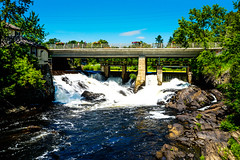 Bracebridge Waterfalls, Ontario, Canada (DDB Photography) Tags: waterfall waterfalls dam bridge bracebridge ontario canada rocks bay river landmark landscape serene peaceful tree trees sky blue clouds lake muskoka cottage country outdoor outdoors harbour harbourfront scenic reflection waterway canal sun photography photographer ddbphotography ddbphotograhy water architecture structure