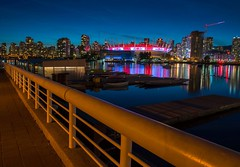 Canadian Flags light up the night at BC Place. (Spencer Finlay) Tags: falsecreek olympicvillage olympics vancouver bluehour reflection canadianflag bcplace
