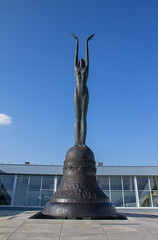 This Sculpture Rings a Bell (Roblawol) Tags: afternoon art artistic baltics bell divine formersovietunion formerussr lithuania pose sculpture standing statue summer televisiontower vilnius woman