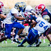 Rhone, Sherman Allen, and Howard on the tackle