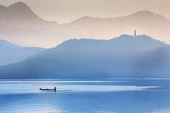 Pagoda and Fisherman at Sun Moon Lake, Taiwan  (Oilfighter) Tags: mountains sunrise pagoda boat fishing fisherman native taiwan rowing fishingboat  sunmoonlake pagodaandfishermanatsunmoonlake