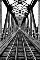 It Pulls Me From Within (Paul B. (Halifax)) Tags: bridge bw nikon traintracks symmetry nb newbrunswick railroadtracks saintjohn d7000 sigma1770mmf2845g