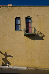 Balcony shadow (steverichard) Tags: travel shadow usa building window yellow wall america hydrant mississippi photo high image balcony firehydrant ms smalltown kosciusko steverichard
