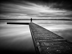 WAITING ON A FRIEND. (Neil Hulme.) Tags: longexposure portrait blackandwhite water monochrome liverpool lumix mono fineart minimalist ndfilter daytimelongexposure nd110filter blackandwhitelongexposure seaandseashore
