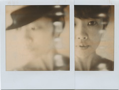 i never understand this woman ( keico) Tags: selfportrait scarlett me hat self polaroid sx70 diptych expired nomakeup firstflush silvershade
