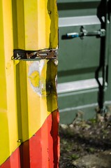 Yellow, Red and Green (boro.boro) Tags: red green colors yellow metal closeup doors bokeh lock colourful detal