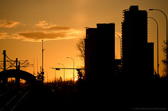 Westgate Park Silhouettes (Witty nickname) Tags: city sunset urban orange sun black trafficlights calgary cars silhouette night clouds buildings lights nikon traffic dusk traintracks tracks silhouettes explore vehicles alberta highrise fullframe condos fx 70300mm goldensunset brava lrt encore ctrain d800 settingsun ovation orangeandblack westgatepark bowtrail nikkor70300mmvr nikond800 sprucecliff westgateparksilhouettes