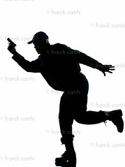 Silhouetted police man running with a handgun (Franck Camhi) Tags: shadow people man black france male silhouette cutout french person one 1 justice holding uniform gun african surveillance authority guard fulllength police running run security safety whitebackground crime mature weapon cop afroamerican law studioshot handgun runner protection officer patrol oneperson policeman armed strict oneman vigilance