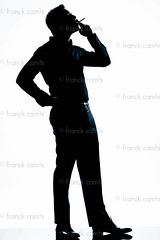 silhouette man full length smoking cigarette (Franck Camhi) Tags: people white man france male silhouette businessman standing cutout person one 1 cigarette profile fulllength style smoking business whitebackground mature studioshot addicted elegant sideview executive addiction enjoying tobacco enjoyment pleasure isolated oneperson stylish elegance caucasian oneman 40years