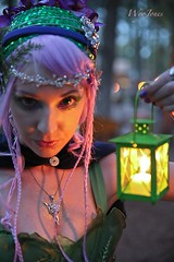 Roxy in the Lamplight (wyojones (Finally Back After A Month Away)) Tags: beautiful beauty look festival tattoo night nose necklace wings eyes lowlight texas expression makeup paige lips fairy faire lamps lovely fairies renaissancefestival roxy bluehair renaissance renfest maiden wench purplehair latterns girlwoman sherwoodforestfaire