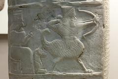 Babylonian boundary stone   British Museum - 19 (Paul Dykes) Tags: uk england london archaeology museum bow record arrow britishmuseum babylonian godofwar boundarystone ninurta landownership taxexemption kudurru kassite