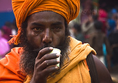 A sadhu taking coffee (Tapas Biswas) Tags: life travel portrait people india color colour face festival festive outdoors happy nikon day view image market candid indian religion culture streetphotography streetlife fair portraiture hindu emotions kolkata ethnicity westbengal candidphotography realpeople d90 indianfestival indianculture hindurituals nikond90 hindupilgrims onlyindian indianfair nikod90 nikond9o