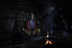 the Adi Galo tribewoman in the village near Daporijo, arunachel pradesh (anthony pappone photography) Tags: travel light portrait woman india house wearing canon fire spirit traditional hut adi ethnic ritratto along shaman fuoco headdress collane arunachal galo etnic capanna arunachalpradesh animist tribeswoman ziro daporijo animisti nyishi neaklaces aditribe nyishitribe donyipolo galotribe nishitribal