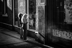 Smoking... (alfie2902) Tags: street nottingham uk people urban bw monochrome mono blackwhite pentax availablelight candid streetphotography streetportrait k5 smcpentaxda40mmf28limited blackwhitestreetphotography alfie2902 alfiewright
