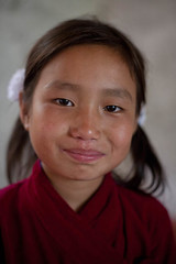 Kala after a busy day at school. (ActionAid UK) Tags: poverty charity school nepal portrait girl smile rural children happy education child photojournalism documentary will gift agency secondary lower development ngo jyoti actionaid