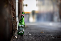 Hollandia Beer Wide Open (Photos By Dlee) Tags: autumn holland beer canon concrete photo bottle bokeh cigarette naturallight litter alcohol alleyway perth handheld product westernaustralia imported wideopen hollandiabeer importedbeer 550d bokehlicious t2i sigma50mm14 kissx4 photosbydlee photosbydlee13