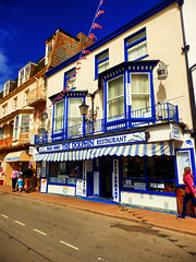 Ilfracombe, North Devon (photphobia) Tags: ilfracombe northdevon uk seaside victorian victorianresort holiday sky oldwivestale outdoor road buildings building buildingsarebeautiful architecture houses shops hotel victorianterrace fishandchips shop thequay chipshop