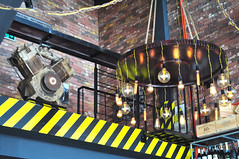 Industrial decor (Roving I) Tags: chandeliers lightglobes bulbs motors engines stripes decor interiordesign architecture chains ropes bricks wine factory danang dining bars vietnam