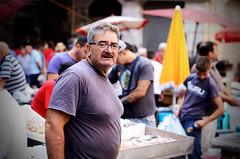 Faces of Piscaria, Catania's fish  market (ciccioetneo) Tags: catania sicilia sicily italia italy piscaria fishmarket pescheria folklore nikond7000 ciccioetneo nikon50mmf14 street streetphotography