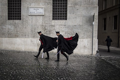 Gone with the wind (Enzo D.) Tags: italy rome roma men wet italia wind streetphotography cloak piazza monte swords lazio unifoms citorio wwwenzodemartinocom