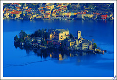 Orta San Giulio and island (Explore #44 18/02/2013) (Tizi@no56 (painting with light)) Tags: blue panorama house lake water landscape