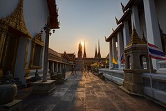 ~ Bangkok Wat Pho Sunset~ (PS~~) Tags: trip travel sunset vacation sky holiday building art history tourism architecture thailand temple photography gold golden asia tour place earth spires bangkok buddha buddhist religion sightseeing buddhism grand palace tourist journey po planet  sight reclining traveling southeast ornate wat visiting pho statuary exploration hindu siam remains  hdr touring deity hindi illuminate thep   travelphotography plated rattanakosin krung  asiatravel    kingdomofthailand totallythailand