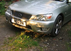 Lexus and Sun (john atte kiln) Tags: sun car silver reflections obsession headlights bumper dappled lexus headlamps cherishedplate